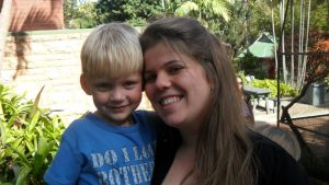 picture of Michelle and her nephew Tyler. In the local botanical gardens